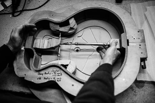 Chris Melville shaping a guitar body