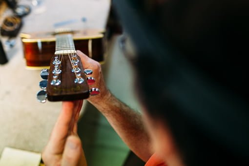 Getting the action right while servicing a guitar in Brisbane