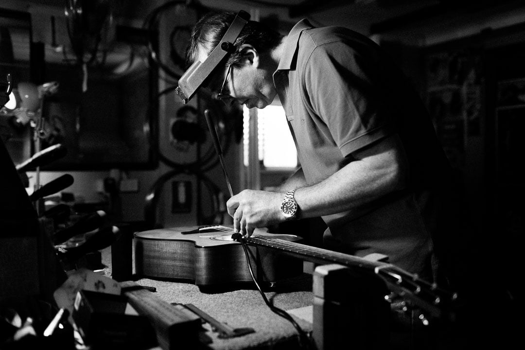 Chris Melville, guitar builder in Brisbane, working on one of his instruments