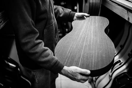 Chris Melville examining a guitar body