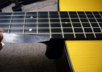 The frets are also lifting all the way down the neck. (2/6)